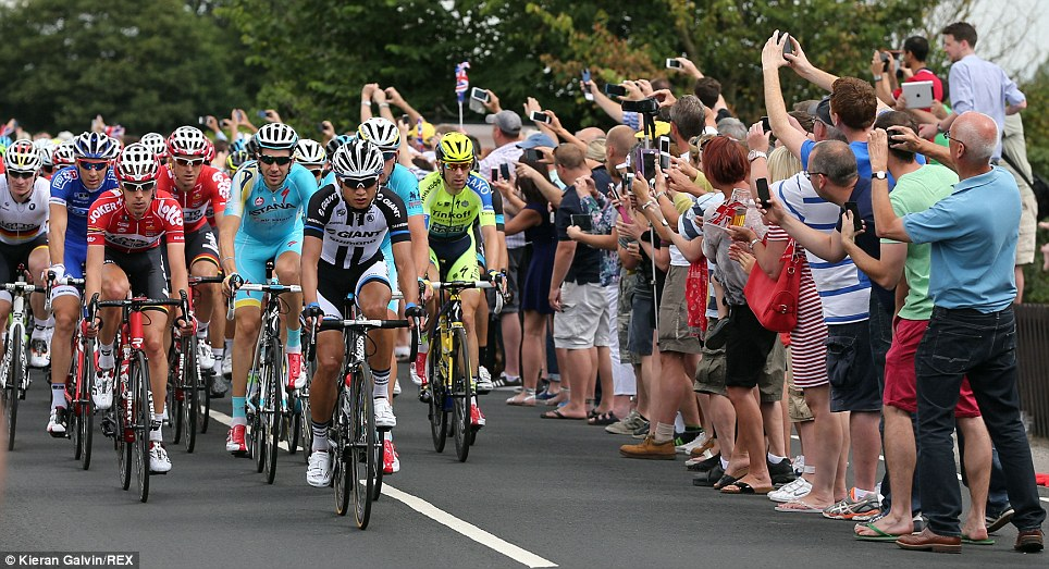 Riders go through the Essex village of Roxwell during the Tour de France's stage three