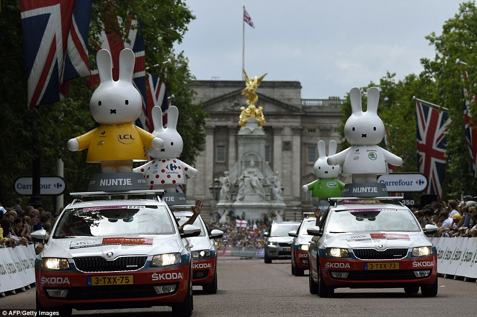Unusual sight: Figurines of Miffy, the popular Dutch rabbit, are seen above official Tour De France cars, in front of Buckingham Palace in London