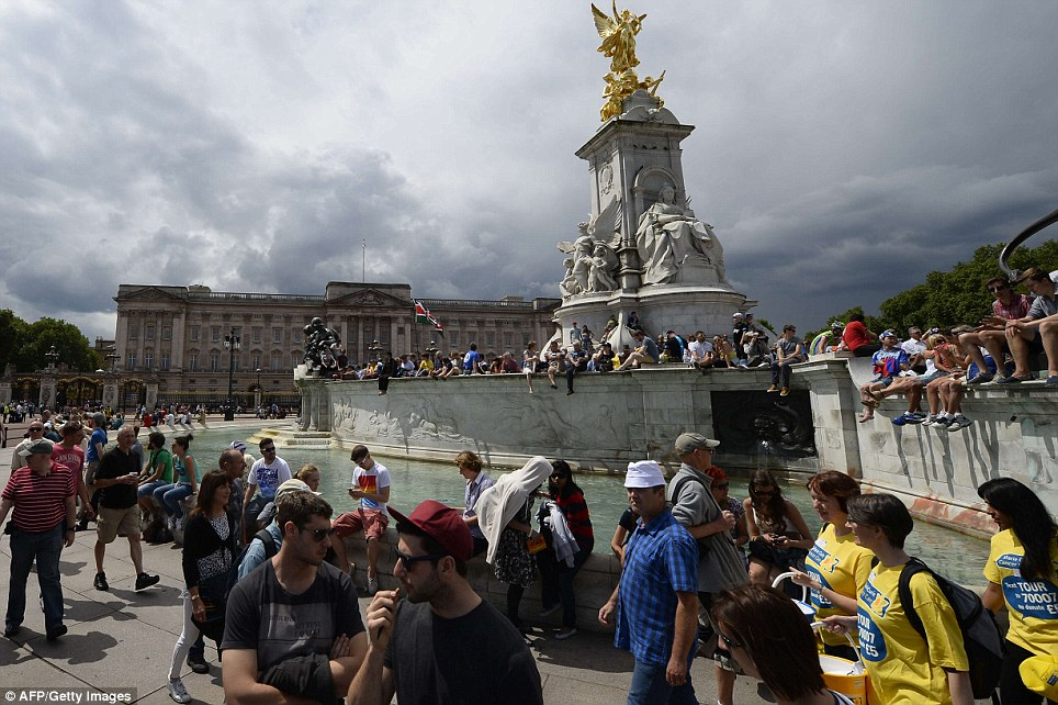 Gathering: Supporters are pictured in front of Buckingham Palace in London during the third stage of the 101st edition of the Tour de France