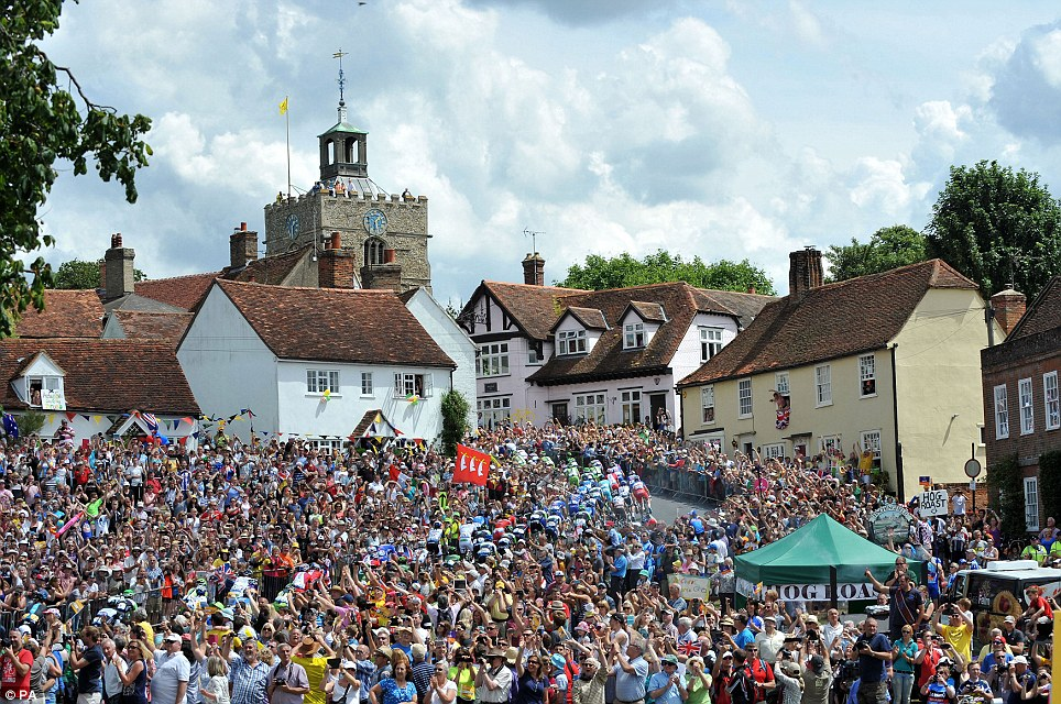Battle: The crowd was 10 deep in parts of the village of Finchingfield in Essex for stage three of the Tour de France