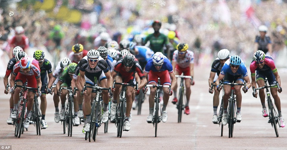 High intensity: Germany's sprinter Marcel Kittel, centre left in black and white jersey, sprints towards the finish line on The Mall to win the third stage