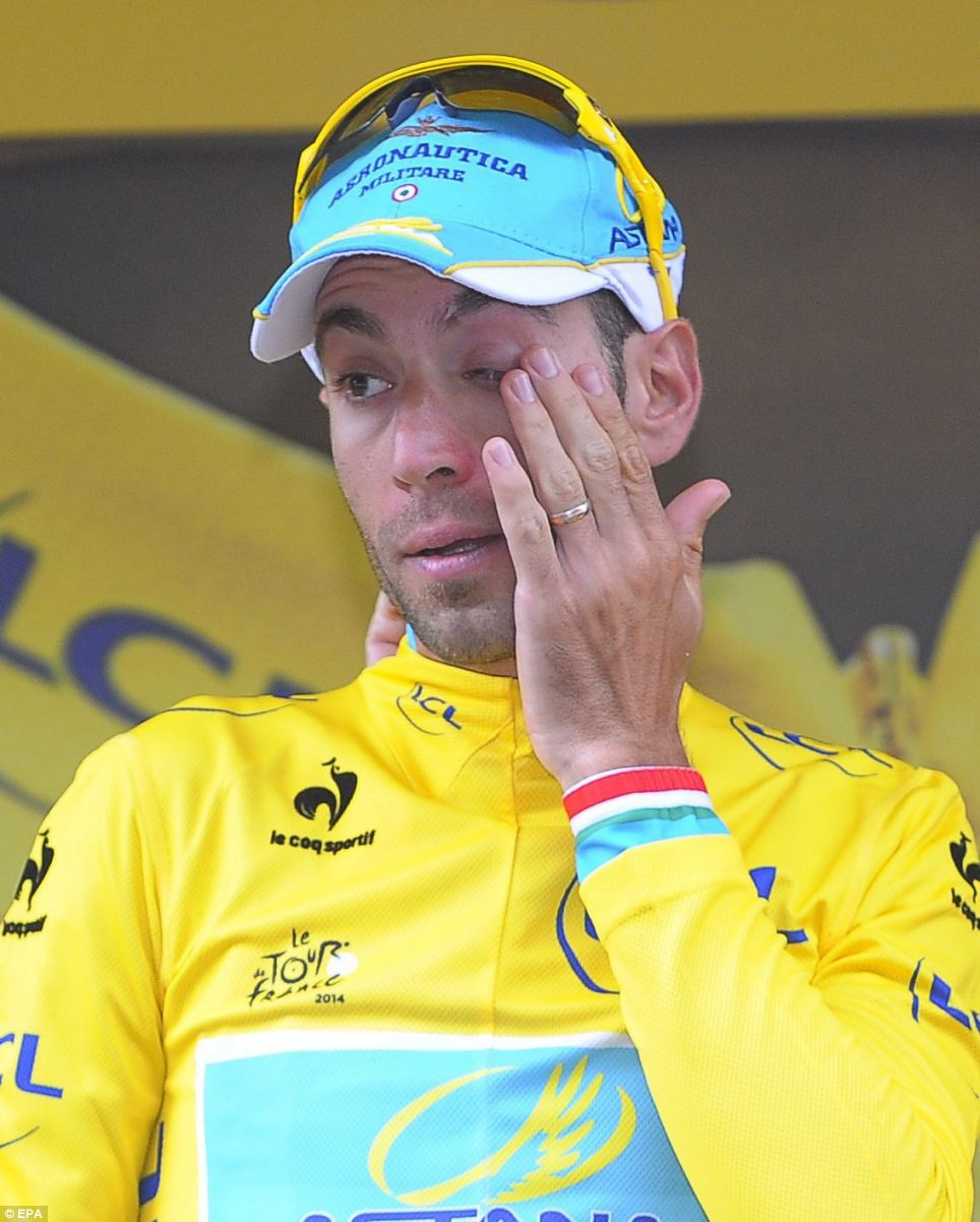 Tears of joy: Vincenzo Nibali is overcome with emotion on the podium as he celebrates wearing the overall leader's yellow jersey following stage three of the Tour