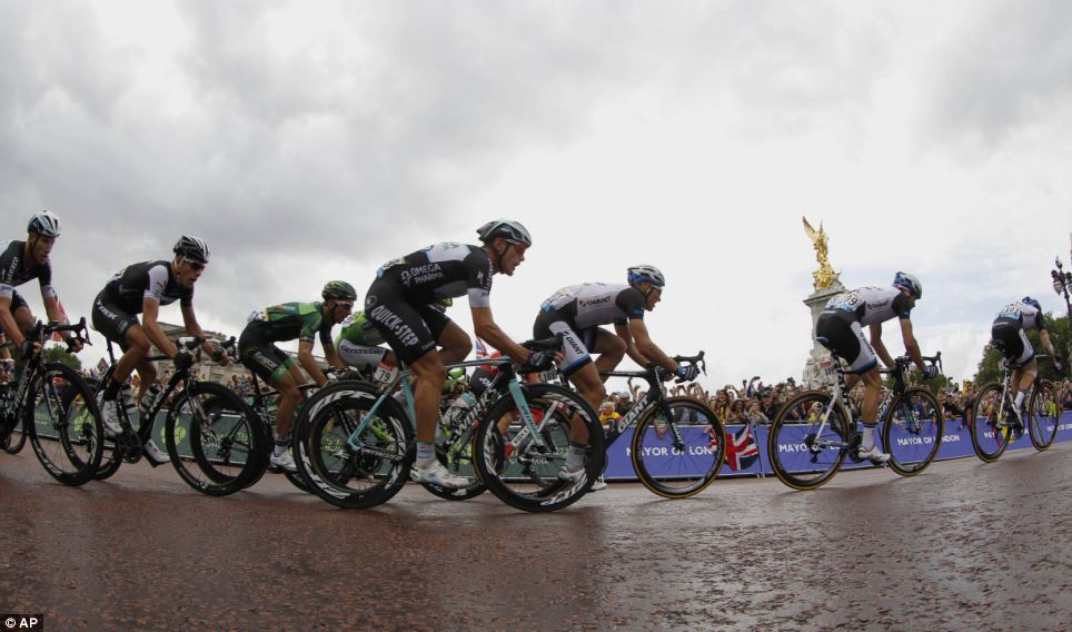 Peloton: The riders cycle past Buckingham Palace as they head towards the big finish at The Mall
