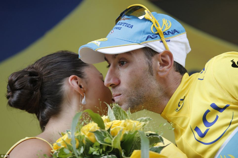 In the lead: Italy's Vincenzo Nibali, wearing the overall leader's yellow jersey, celebrates on the podium of the third stage of the Tour de France
