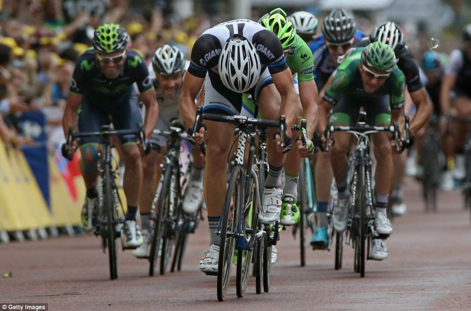 Head down: Marcel Kittel powered to victory in today's stage three of the Tour. The Tour will now move to France where riders will battle it out tomorrow after setting off from Le Touquet to Lille at 12.30pm