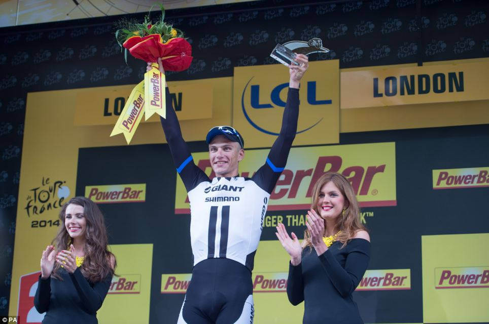 Celebrations: Marcel Kittel celebrates winning today's stage 3 of the Tour which finished at The Mall in central London after starting in Cambridge
