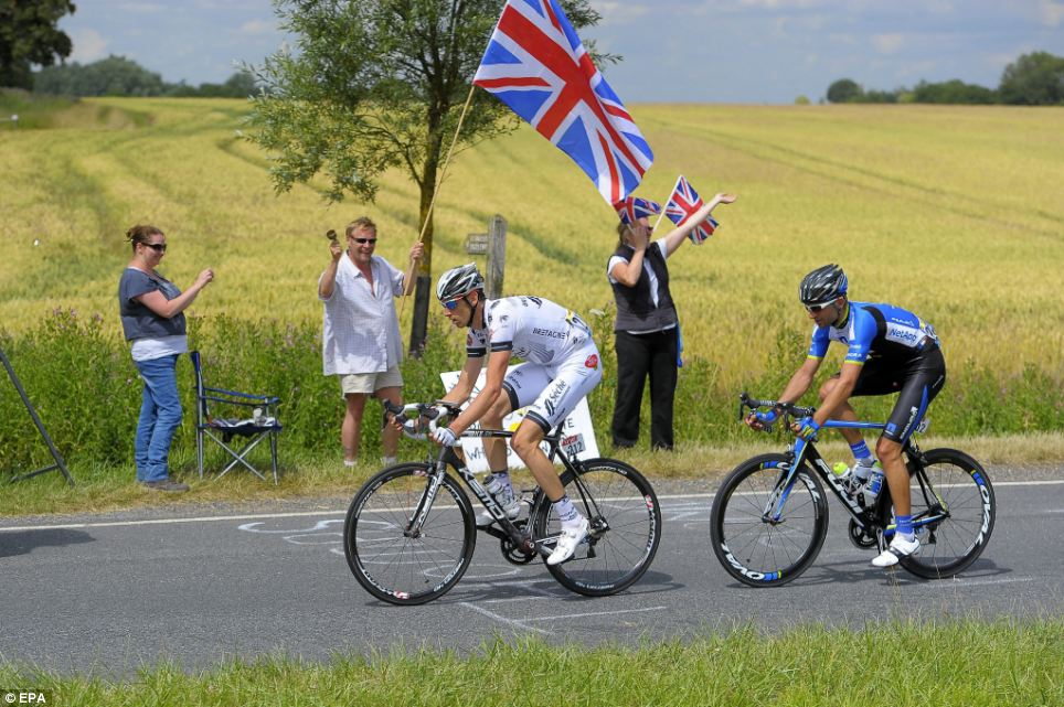British countryside: Riders break away during the third stage between Cambridge and London as the cyclists compete in front of a stunning backdrop of rural Britain