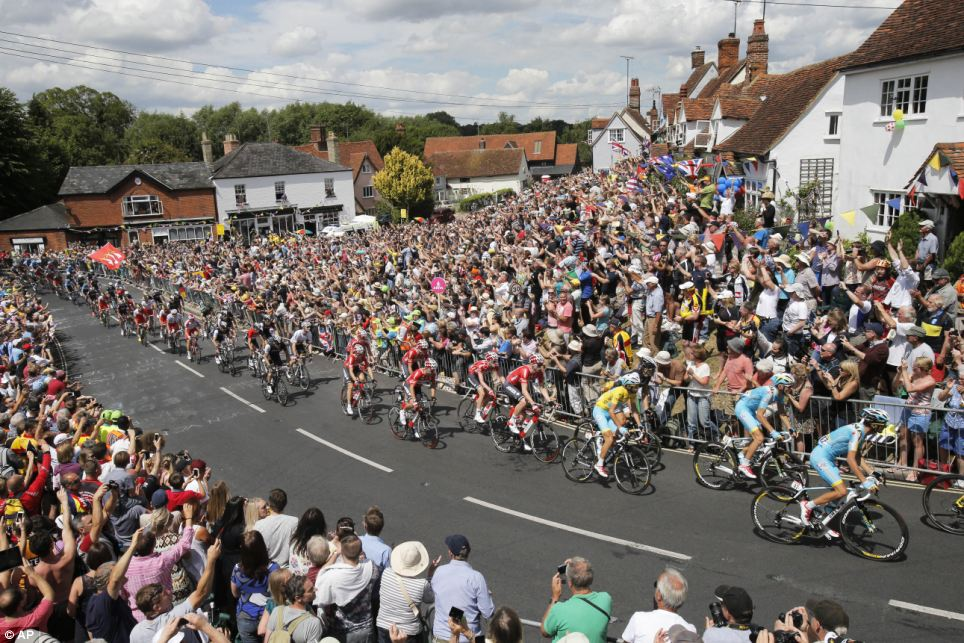 Packed: Thousands of fans lined the streets of Cambridge this morning as the race got underway and the contingent started their journey to London
