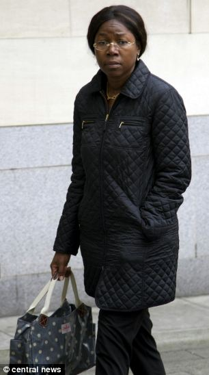 Fraudster Mirriam Clark pictured before her sentencing outside Southwark Crown Court today