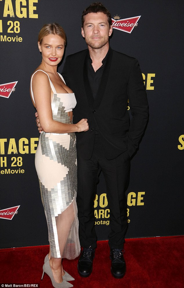 Taking the plunge: Lara is dating Sam Worthington, pictured here at the Sabotage premiere in Los Angeles