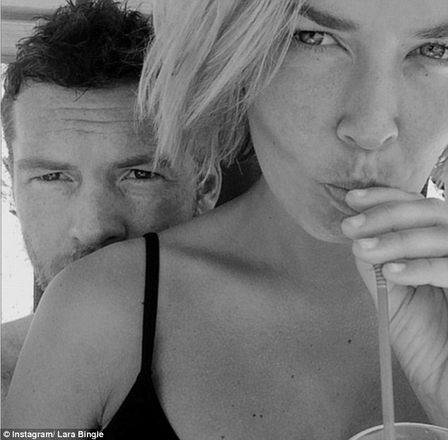 Cheers! Lara Bingle posted a flashback picture of herself and Sam Worthington on holiday in Italy on Monday