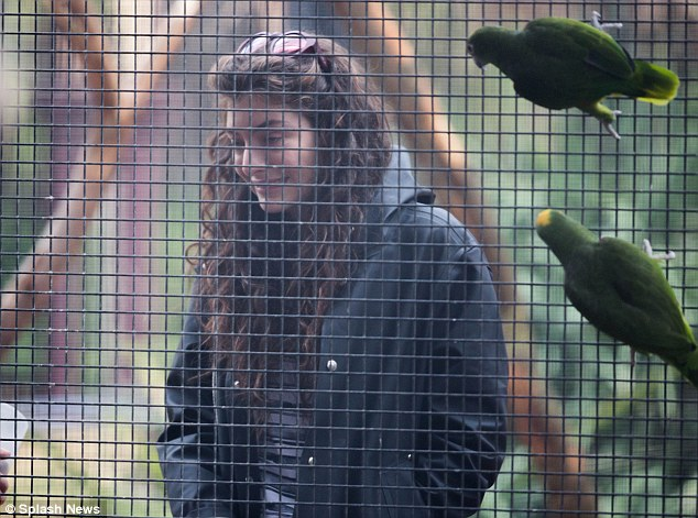 Free as a bird! The 17-year-old enjoyed some downtime between shows, taking in a bird enclosure and the Pandas