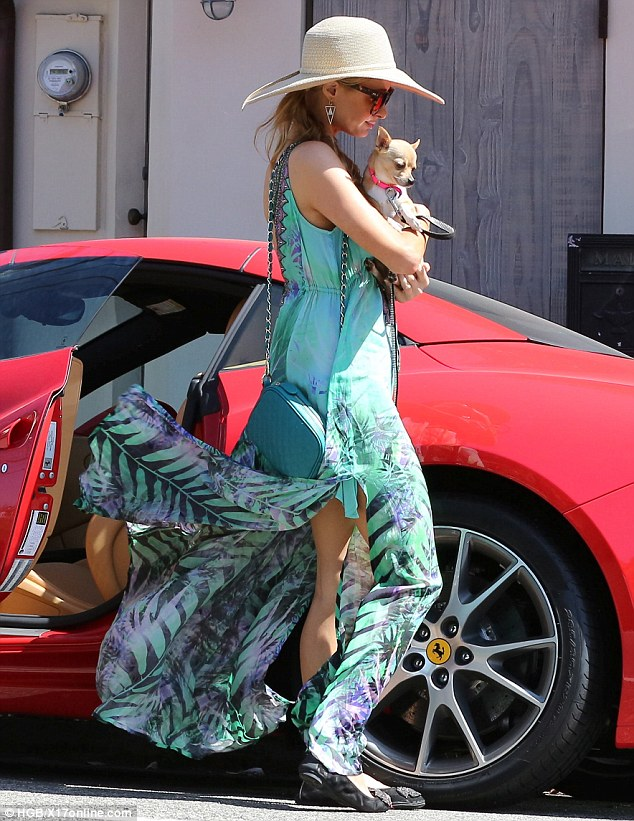 Safety first: Paris made sure to drive in a pair of flats before switching into her sexier high heels