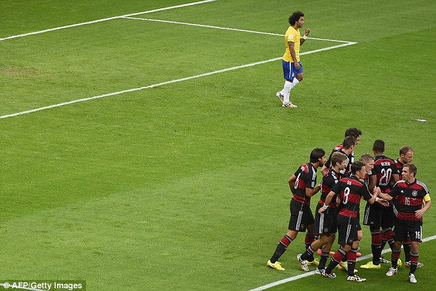 Implosion: Brazil's Marcelo cuts a lonely figure as Germany run riot in the semi final to put their 5-1 loss firmly behind