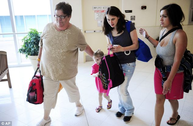 Victoria traveled with her mother, Tina Wilcher, center, and Janet Kellum, left, whose stepson is the family¿s attorney in Jackson, Miss.