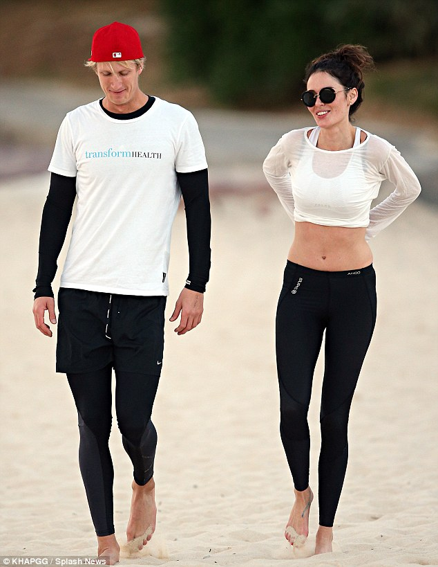 Endorphin high:: The stunning supermodel took advantage of inviting Bondi beach to run along the soft sand