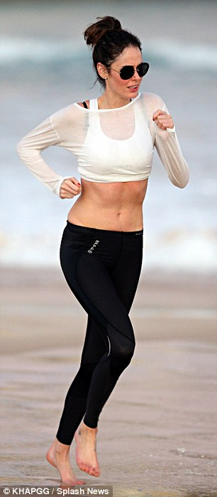 Looking good: The self-style supermodel took advantage of the scenic backdrop of the crashing waves to exercise