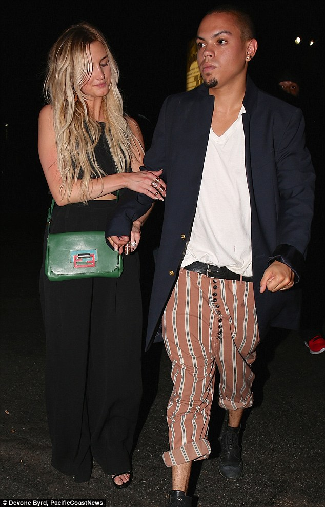 Cute couple: Ashlee 29 looked chic in a black jumpsuit and left her thick blonde hair tousled. The pair are set to wed on Labor Day in Connecticut