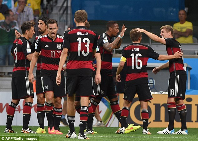 Goals galore: Toni Kroos (right) celebrates after scoring Germany's third
