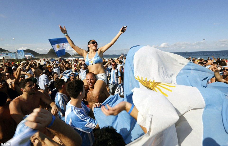 Taken over: Argentinian fans have crowded onto the Copacabana beach in Rio de Janeiro ahead of their semi-final encounter with Holland