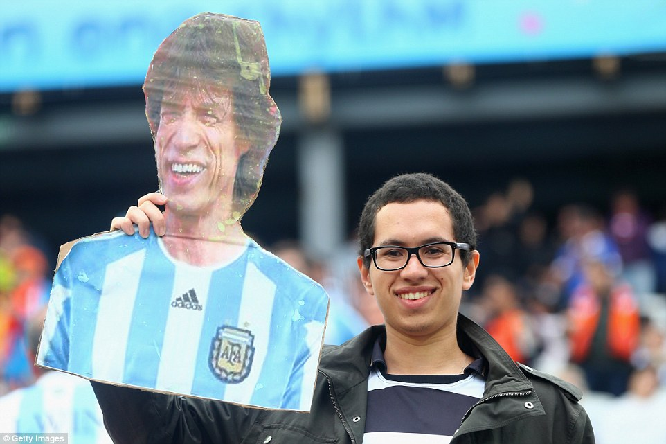 SAO PAULO, BRAZIL - JULY 09:  A fan holds up a cutout of Mick Jagger in an Argentina jersey prior to the 2014 FIFA World Cup Brazil Semi Final match between the Netherlands and Argentina at Arena de Sao Paulo on July 9, 2014 in Sao Paulo, Brazil.  (Photo by Jamie Squire/Getty Images)