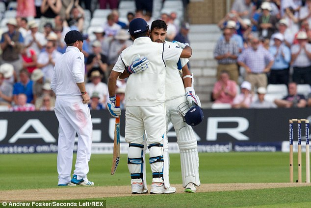 Captain's approval: India skipper MS Dhoni embraces Vijay (facing) after bringing up his hundred