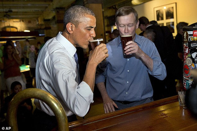 'That's some tasty beer!' President Barack Obama has a beer at Wynkoop Brewing Co. with Colorado Gov. John Hickenlooper on Tuesday