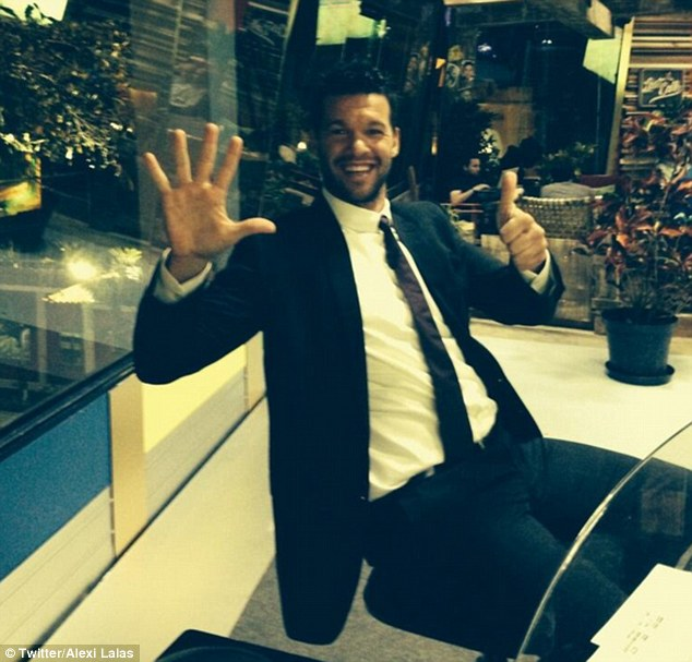 Seventh heaven: Michael Ballack salutes the victory while working as a TV pundit