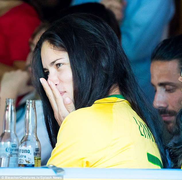Crushing: Adriana Lima was equally devastated with the effort of her home side