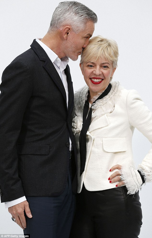 He's loving those locks: Baz got a bit closer to his costume designer wife's new hair as they posed at the Grand Palais