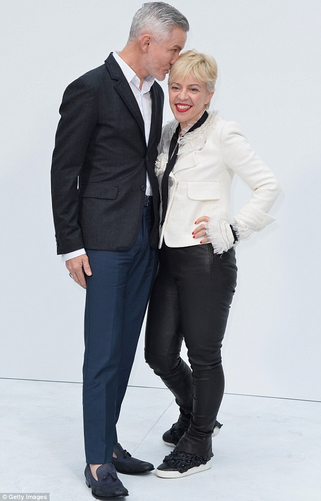 Looking chic: Catherine opted for a monochrome ensemble complete with a white frilled blazer and black leather trousers