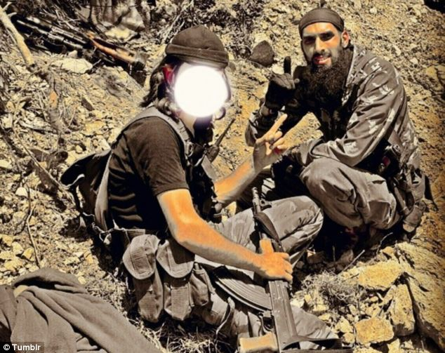 The Dutch fighter confirmed via Skype he had been training people as young as 16 to take part in the conflict. Above, a photo, posted to Tumblr, shows Yilmaz sat with another rebel in the town of Kasab in north-west Syria