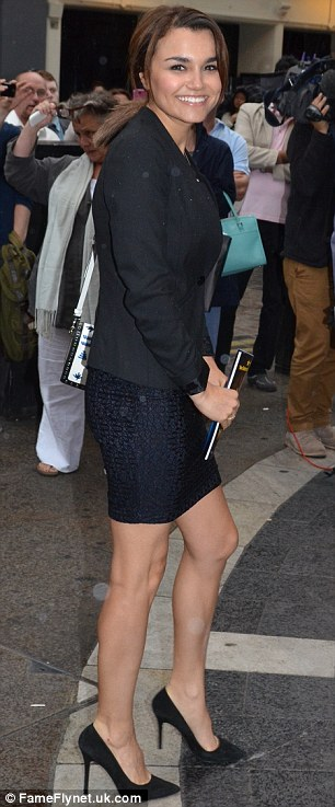 Beaming: Samantha clutched a programme as she walked into the event