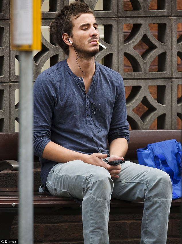 Troubled: Photos have emerged of the actor from May 2013, where he can be seen at bus stop in Sydney's Kings Cross