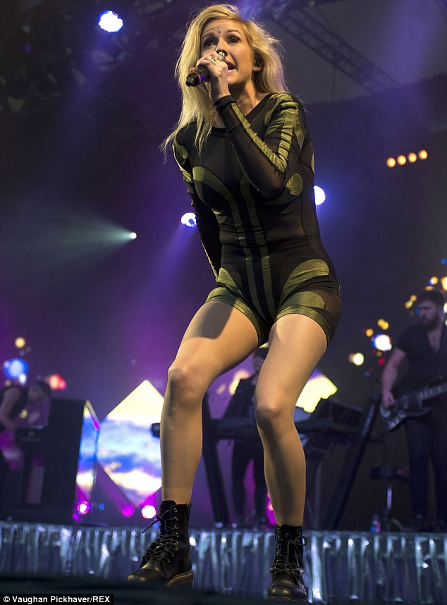Goodness Gracious: The hitmaker flashed her toned pins in the black,  skintight bodysuit as she sang some of her biggest tunes