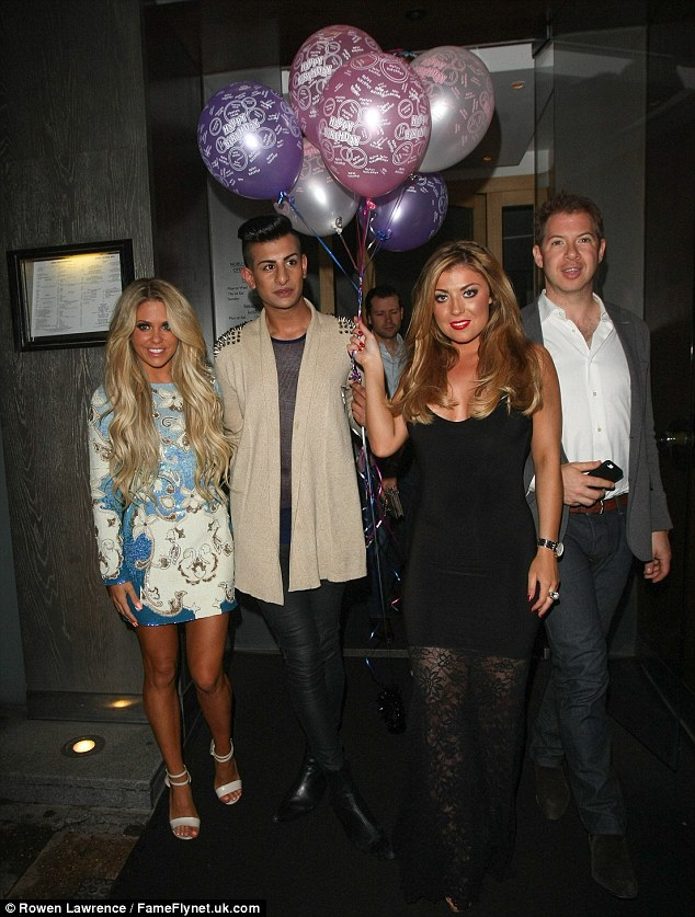 Birthday girl: Abi opted for a black dress which highlighted her legs thanks to the sheer lace skirt