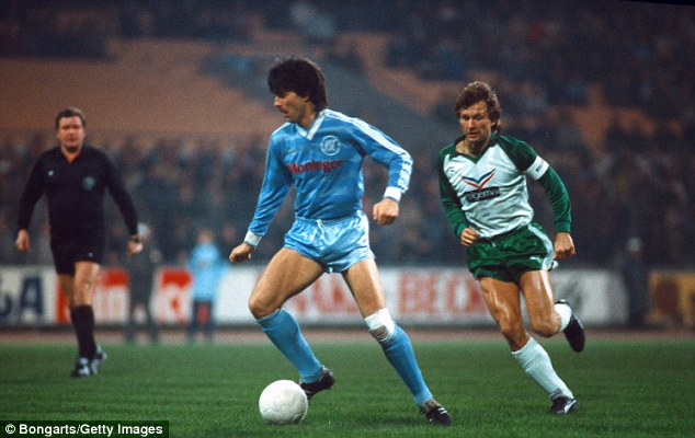Playing days: A younger Low (left), who was a midfielder, in action for Karlsruher SC in 1984