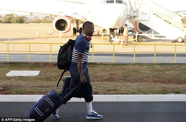Future sorted? Evra returns home after France were eliminated from the World Cup against Germany