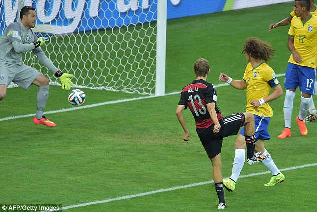 Start of the rout: Muller took advantage of awful Brazil defending to score Germany's opening goal