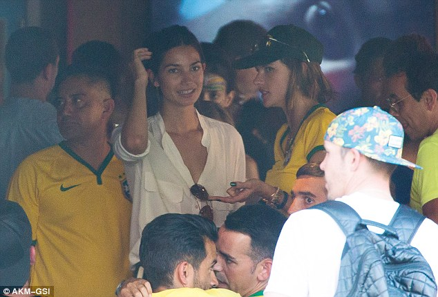 Baptism of fire: Fellow Victoria's Secret model Lily Aldridge also joined the festivities and watched the match