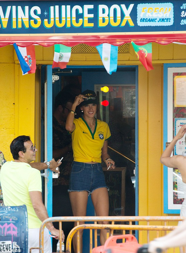 Dressed to impress: The leggy lass donned a Brazil top emblazoned with the number 10 and her nickname 'Alé'
