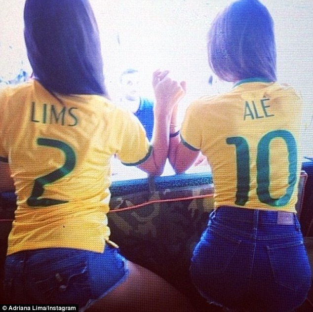 Come on Brazil: Lima and Ambrosio showed support for Brazil as they took on Germany in the World Cup semi-final