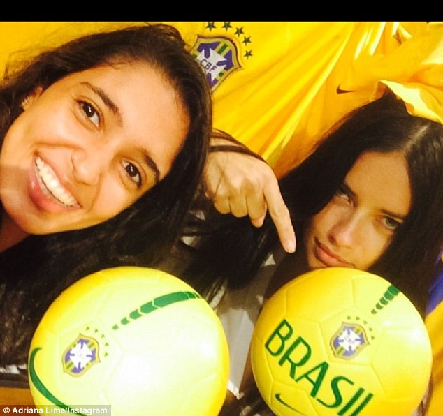 It's all fun and games! Adriana posed with a couple of footballs with a friend as they got into the spirit of the occasion