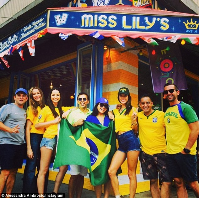 Support system: The pair took to Miss Lily's with a group of pals to watch the game
