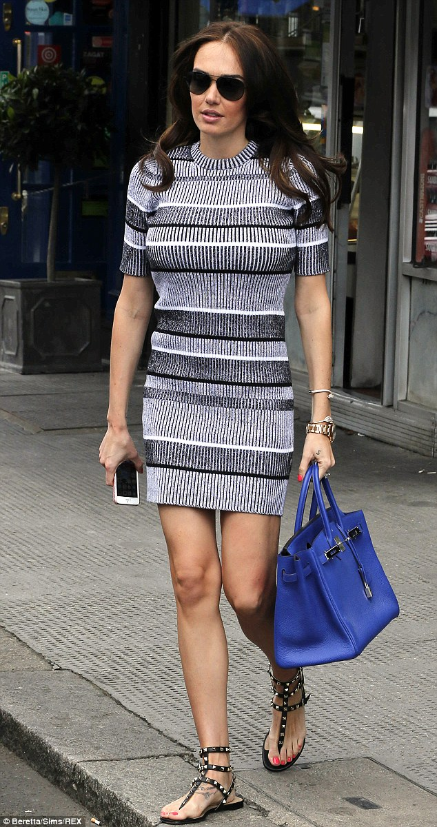 Stars in stripes: Tamara looked demure in a jumper dress, which she teamed with gladiator-style sandals