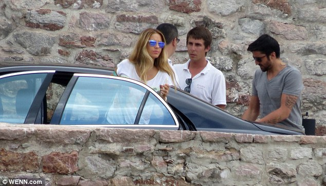 Here come the guests: Fellow Serbian tennis player Janko Tipsarevic and his wife Biljana were spotted arriving at the wedding venue
