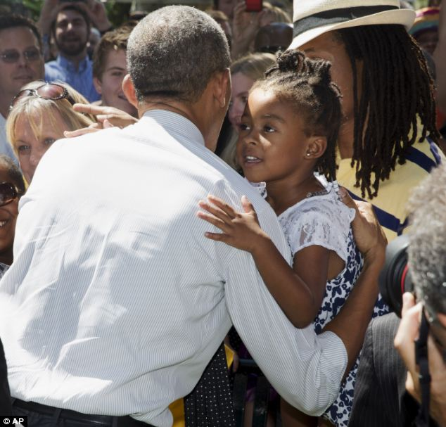 This child, not that child: Obama hugged a young girl in Denver but has no plans to see thousands of less fortunate children massed on the U.S. border a few hundred miles south of his Texas travel swing