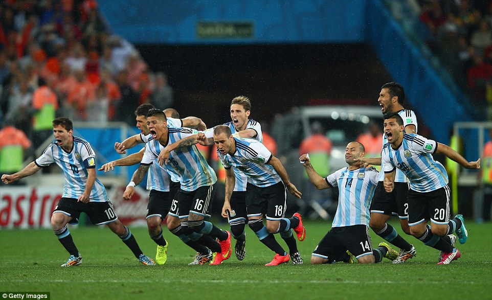 One game away: The Argentine players fun from the halfway line in celebration after Maxi Rodriguez's successful penalty secures their place in Sunday's final