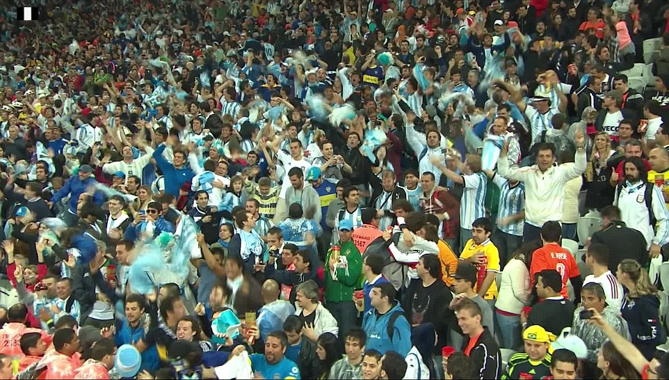 Wild celebrations: Argentine fans inside the Corinthians Arena react as their side book a place in Sunday's World Cup final against Germany
