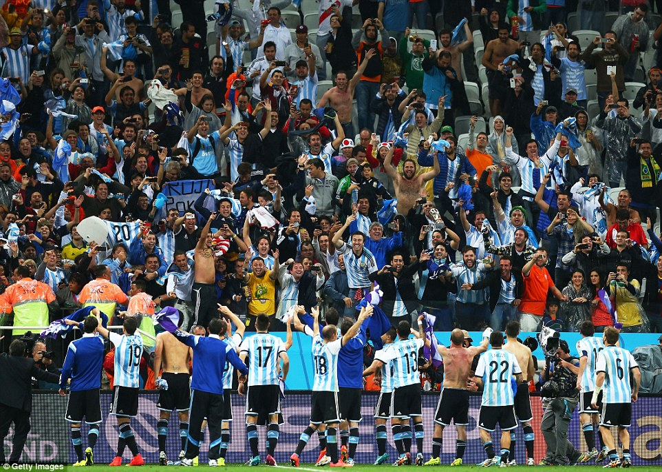 Appreciation: The victorious Argentine players walk over and salute their fans after beating Holland 4-2 on penalties